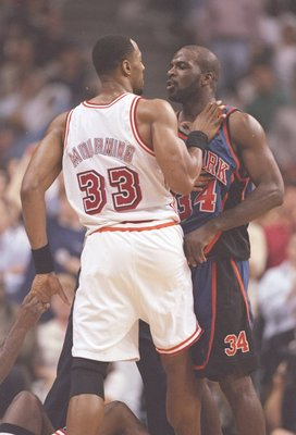 14 May 1997:  Center Alonzo Mourning of the Miami Heat dribbles and forward Charles Oakley of the New York Knicks push each other during a playoff game at the Miami Arena in Miami, Florida.  The Heat won the game 96-81. Mandatory Credit: Andy Lyons  /Alls