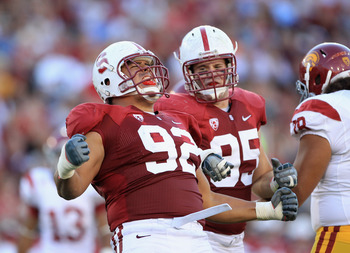 PALO ALTO, CA - OCTOBER 09: Sione Fua #92 of the Stanford Cardinal celebrates after he sacked Matt Barkley #7  of the USC Trojans at Stanford Stadium on October 9, 2010 in Palo Alto, California.  (Photo by Ezra Shaw/Getty Images)