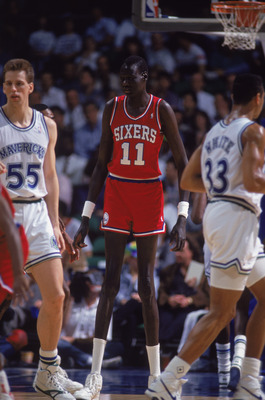 1990:  Manute Bol #11 of the Philadelphia 76ers moves on the floor during the game against the Dallas Mavericks NOTE TO USER: User expressly acknowledges and agrees that, by downloading and/or using this Photograph, User is consenting to the terms and con