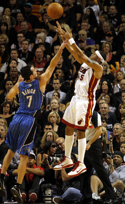 MIAMI - OCTOBER 29:  Guard Eddie House #55 of the Miami Heat shoots against guard J.J. Redick #7 of the Orlando Magic at American Airlines Arena on October 29, 2010 in Miami, Florida.  NOTE TO USER: User expressly acknowledges and agrees that, by download