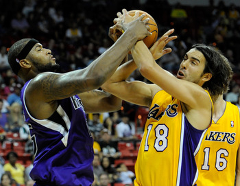 LAS VEGAS - OCTOBER 13:  DeMarcus Cousins #15 of the Sacramento Kings and Sasha Vujacic #18 of the Los Angeles Lakers fight for a rebound during their preseason game at the Thomas & Mack Center October 13, 2010 in Las Vegas, Nevada. The Lakers won 98-95.