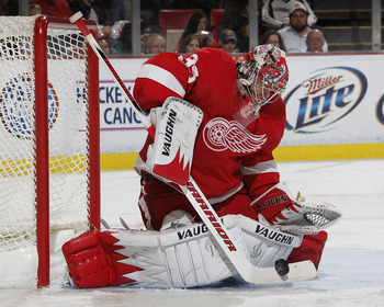 DETROIT - OCTOBER 21: Jimmy Howard #35 of the Detroit Red Wings makes a third period save while playing the Calfary Flames on October 21, 2010 at Joe Louis Arena in Detroit, Michigan. Detroit won the game 4-2. (Photo by Gregory Shamus/Getty Images)
