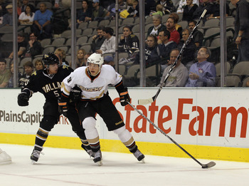 DALLAS - OCTOBER 26:  Bobby Ryan #9 of the Anaheim Ducks skates against Matt Niskanen #5 of the Dallas Stars as a Niskanen's stick goes airborne at the American Airlines Center on October 26, 2010 in Dallas, Texas. The Ducks defeated the Stars 5-2.  (Phot