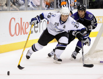 LOS ANGELES, CA - NOVEMBER 04:  Martin St. Louis #26 of the Tampa Bay Lightning fends off Jarret Stoll #28 of the Los Angeles Kings during the third period at Staples Center on November 4, 2010 in Los Angeles, California.  (Photo by Harry How/Getty Images