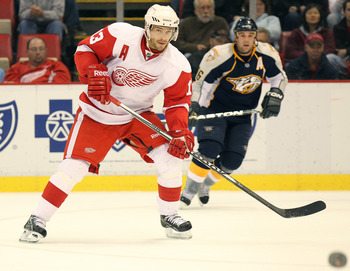 DETROIT,MI - OCTOBER 30:  Pavel Datsyuk #13 of the Detroit Red Wings waits for a puck in a game against the Nashville Predators on October 30,2010 at the Joe Louis Arena in Detroit , Michigan. The Wings defeated the Predators 5-2. (Photo by Claus Andersen