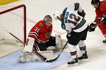 CHICAGO - MAY 21:  Patrick Marleau #12 of the San Jose Sharks shoots the puck as goaltender Antti Niemi #31 of the Chicago Blackhawks makes a save in overtime of Game Three of the Western Conference Finals during the 2010 NHL Stanley Cup Playoffs at the U