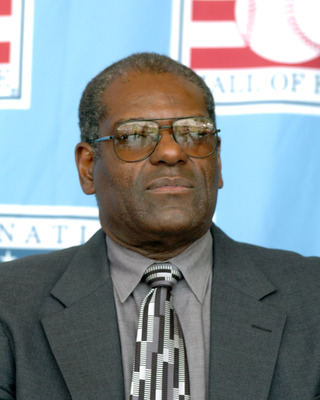 Bob Gibson watches 2004  Baseball Hall of Fame induction ceremonies  July 25, 2004 in Cooperstown, New York. (Photo by A. Messerschmidt/Getty Images) *** Local Caption ***