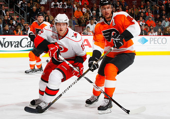 PHILADELPHIA - NOVEMBER 01:  Jeff Carter #17 of the Philadelphia Flyers battles for position against Jiri Tlusty #19 of the Carolina Hurricanes on November 1, 2010 at the Wells Fargo Center in Philadelphia, Pennsylvania. Flyers defeat the Hurricanes 3-2.