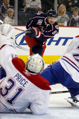 COLUMBUS,OH - NOVEMBER 2:  Rick Nash #61 of the Columbus Blue Jackets fires a shot on Carey Price #31 of the Montreal Canadiens during the second period on November 2, 2010 at Nationwide Arena in Columbus, Ohio.  (Photo by John Grieshop/Getty Images)