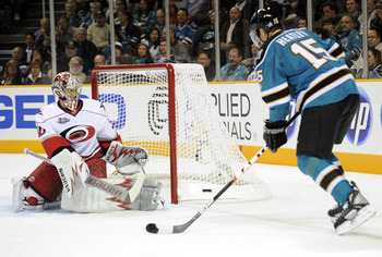 SAN JOSE, CA - OCTOBER 19:  Dany Heatley #15 of the San Jose Sharks has his shot deflected by goalie Cam Ward #30 of the Carolina Hurricanes during an NHL hockey game at the HP Pavilion October 19, 2010 in San Jose, California. (Photo by Thearon W. Hender
