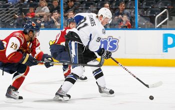 ATLANTA - OCTOBER 22:  Steven Stamkos #91 of the Tampa Bay Lightning controls the puck against Johnny Oduya #29 of the Atlanta Thrashers at Philips Arena on October 22, 2010 in Atlanta, Georgia.  (Photo by Kevin C. Cox/Getty Images)