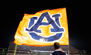 AUBURN, AL - SEPTEMBER 18:  Cheerleaders of the Auburn Tigers fly their flag during the game against the Clemson Tigers at Jordan-Hare Stadium on September 18, 2010 in Auburn, Alabama.  (Photo by Kevin C. Cox/Getty Images)