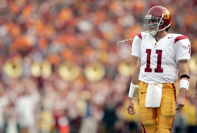 PASADENA, CA - DECEMBER 4:  Quarterback Matt Leinart #11 of the USC Trojans spits out water during the game against the UCLA Bruins on December 4, 2004 at the Rose Bowl in Pasadena, California.  (Photo by Jeff Gross/Getty Images)