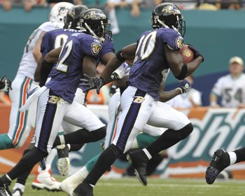 MIAMI, FL - JANUARY 4:  Safety Ed Reed #20 of the Baltimore Ravens returns an interception against the Miami Dolphins in an NFL Wildcard Playoff Game at Dolphins Stadium on January 4, 2009 in Miami, Florida.  (Photo by Al Messerschmidt/Getty Images)