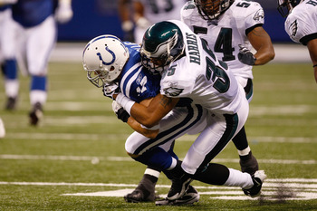 INDIANAPOLIS, IN - AUGUST 20: Wide receiver Austin Collie #17 of the Indianapolis Colts is tackled by defensive back Macho Harris #35 of the Philadelphia Eagles at Lucas Oil Stadium on August 20, 2009 in Indianapolis, Indiana. (Photo by Scott Boehm/Getty