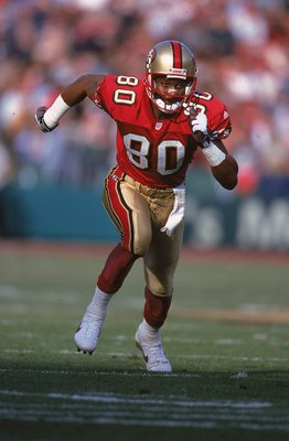 12 Dec 1999:  Jerry Rice #80 of the San Francisco 49ers runs on the field during the game against the Atlanta Falcons at 3 Comm Park in San Francisco, California. The 49ers defeated the Falcons 26-7. Mandatory Credit: Tom Hauck  /Allsport