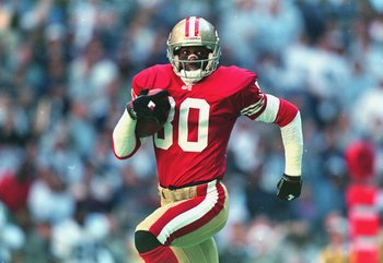 12 Nov 1995: Jerry Rice #80 of the San Francisco 49ers runs for a touch down during the game against the Dallas Cowboys at the Texas Stadium in Irving, Texas. The 49ers defeated the Cowboys 38-20.