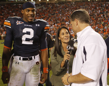 AUBURN - OCTOBER 16:  CBS sideline reporter Tracy Wolfson (center) interviews Auburn University head coach Gene Chizik (right) while Auburn Tigers quarterback Cam Newton #2 looks on after the game against the Arkansas Razorbacks at Jordan-Hare Stadium on