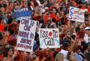 AUBURN, AL - OCTOBER 23:  Fans of the Auburn Tigers hold up signs about quarterback Cameron Newton #2 during the game against the LSU Tigers at Jordan-Hare Stadium on October 23, 2010 in Auburn, Alabama.  (Photo by Kevin C. Cox/Getty Images)