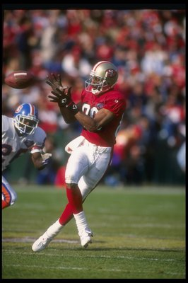 17 Dec 1994:  Wide receiver Jerry Rice of the San Francisco 49ers catches the ball during a game against the Denver Broncos at Candlestick Park in San Francisco, California.  The 49ers won the game, 42-19. Mandatory Credit: Stephen Dunn  /Allsport