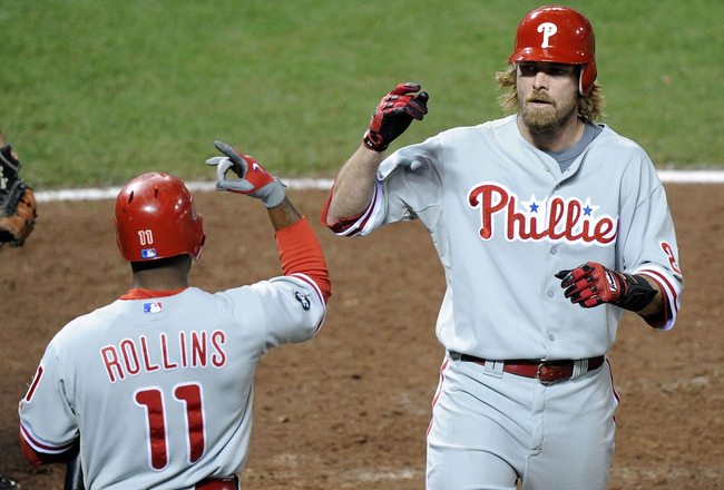 SAN FRANCISCO - OCTOBER 21:  Jayson Werth #28 of the Philadelphia Phillies celebrates a solo homerun against the San Francisco Giants with teammate Jimmy Rollins #11 in the ninth inning of Game Five of the NLCS during the 2010 MLB Playoffs at AT&T Park on
