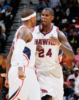 ATLANTA - OCTOBER 21:  Marvin Williams #24 of the Atlanta Hawks reacts with Josh Smith #5 after Williams' dunk against the Miami Heat at Philips Arena on October 21, 2010 in Atlanta, Georgia.  (Photo by Kevin C. Cox/Getty Images)