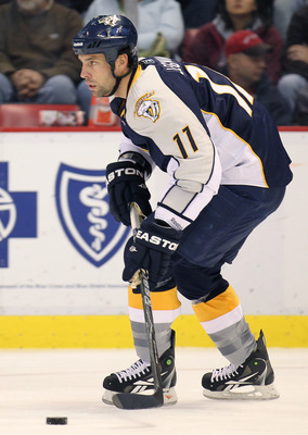 DETROIT,MI - OCTOBER 30:  David Legwand #11 of the Nashville Predators skates with the puck in a game against the Detroit Red Wings on October 30,2010 at the Joe Louis Arena in Detroit , Michigan. The Wings defeated the Predators 5-2. (Photo by Claus Ande