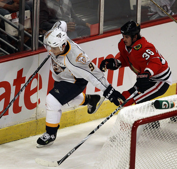 CHICAGO - OCTOBER 13: Marcel Goc #9 of the Nashville Predators chases down the puck in front of Dave Bolland #36 of the Chicago Blackhawks at the United Center on October 13, 2010 in Chicago, Illinois. The Predators defeated the Blackhawks 3-2.  (Photo by