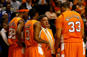 NASHVILLE, TN - MARCH 13:  Head coach Bruce Pearl of the Tennessee Volunteers talks with Scotty Hopson #32, Bobby Maze #3 and Brian Williams #33 against the Kentucky Wildcats during the semirfinals of the SEC Men's Basketball Tournament at the Bridgestone