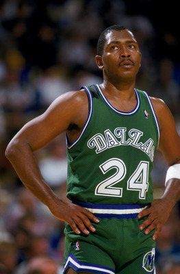 LOS ANGELES - 1987:  Mark Aguirre #24 of the Dallas Mavericks stands on the court during the NBA game against the Los Angeles Lakers at the Great Western Forum in Los Angeles, California in 1987.  (Photo by Stephen Dunn/Getty Images)