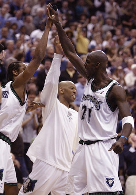 MINNEAPOLIS - APRIL 30:  Kevin Garnett #21 of the Minnesota Timberwolves celebrates with teammates Latrell Sprewell #8 and Sam Cassell #19 during a time out against the Denver Nuggets in Game 5 of the Western Conference Quarterfinals during the NBA playof