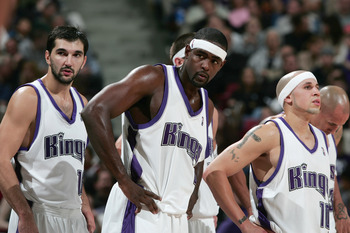 SACRAMENTO, CA - NOVEMBER 19:  Peja Stojakovic #16 of the Sacramento Kings stands next to his teammates Chris Webber #4 and Mike Bibby #10 during the game against the Memphis Gizzlies at Arco Arena on November 19, 2004 in Sacramento, California.  The King