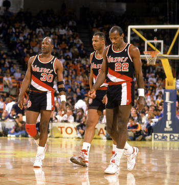 LOS ANGELES - 1990:  Jerome Kersey #25, Terry Porter #30, and Clyde Drexler #22 of the Portland Trail Blazers walk during the 1989-1990 NBA season game at the Great Western Forum in Los Angeles, California.  (Photo by Ken Levine/Getty Images)