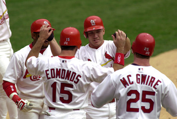 6 Apr 2000: J.D. Drew #7 of the St. Louis Cardinals is congratulated by teammates Fernando Tatis #23, Jim Edmonds #15 and Mark McGwire #25 after Drew hit a grand slam in the fourth inning against the Chicago Cubs at Busch Stadium in St. Louis, Missouri.DI