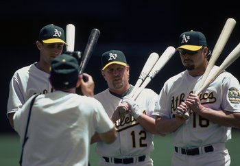 29 Jun 2000:  Jason Giambi, Ben Grieve, and Matt Stairs of Oakland Athletics get their picture taken by A's photographer Michael Zagaris during the game against the Texas Reangers at the Network Associates Coliseum in Oakland, California. The Rangers defe