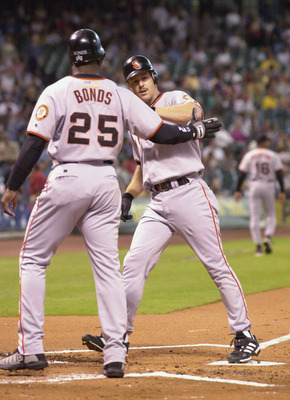 4 Oct 2001:  Barry Bonds #25 of the San Francisco Giants greets teammate Jeff Kent #21 at the plate after a 2 run homerun during the first inning against the Houston Astros at Enron Field in Houston, Texas. DIGITAL IMAGE  Mandatory Credit: Harry How/ALLSP