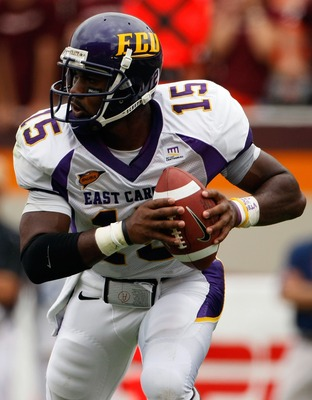 BLACKSBURG, VA - SEPTEMBER 01:  Quarterback Patrick Pinkney of the East Carolina Pirates rolls out of the pocket to pass in the third quarter against the Virginia Tech Hokies on September 1, 2007 at Lane Stadium in Blacksburg, Virginia. Virginia Tech won