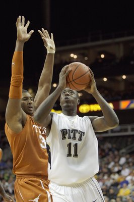 KANSAS CITY,MO - NOVEMBER 24:  Dante Taylor #11 of the Pittsburgh Panthers puts a shot up against Dexter Pittman #34 of the Texas Longhorns during the CBE Classic championship game on November 24, 2009 at Sprint Center in Kansas City, Missouri. (Photo by:
