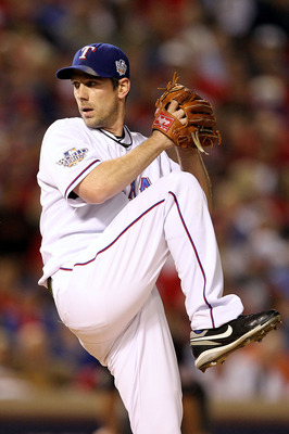 ARLINGTON, TX - NOVEMBER 01:  Starting pitcher Cliff Lee #33 of the Texas Rangers pitches against the San Francisco Giants in Game Five of the 2010 MLB World Series at Rangers Ballpark in Arlington on November 1, 2010 in Arlington, Texas. The Giants won 3