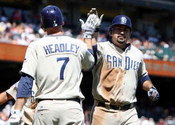 SAN FRANCISCO - SEPTEMBER 09:  Adrian Gonzalez #23 of the San Diego Padres celebrates with teammate Chase Headley #7 after hitting a home run in the third inning against the San Francisco Giants during a Major League Baseball game at AT&T Park on Septembe