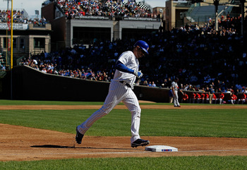 CHICAGO - SEPTEMBER 24: Aramis Ramirez #16 of the Chicago Cubs touches third base after hitting a solo home run in the 2nd inning against the St. Louis Cardinals at Wrigley Field on September 24, 2010 in Chicago, Illinois. (Photo by Jonathan Daniel/Getty