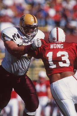 26 Oct 1996:  Offensive lineman Juan Roque of the Arizona State Sun Devils engages his opponent Kailee Wong #13 of the Stanford Cardinal during a pass play in the Sun Devils 41-9 victory over the Cardinal at Stanford Stadium in Palo Alto, California.