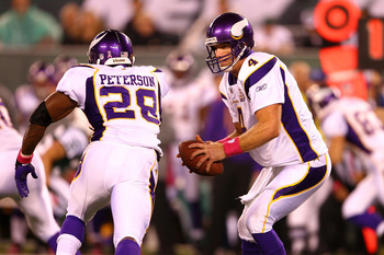 Vikings Quarterback Brett Favre (right) and Running Back Adrian Peterson (left)