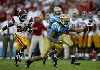 PASADENA, CA - DECEMBER 02:  Dennis Keyes #11 of the UCLA Bruins tries to recover a fumble on a kickoff return during the game against the USC Trojans on December 2, 2006 at the Rose Bowl in Pasadena, California. The UCLA Bruins defeated the USC Trojans 1
