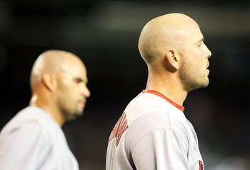 PHOENIX - APRIL 19:  Matt Holliday #7 and Albert Pujols #5 of the St. Louis Cardinals during the Major League Baseball game against the Arizona Diamondbacks at Chase Field on April 19, 2010 in Phoenix, Arizona. The Cardinals defeated the Diamondbacks 4-2.