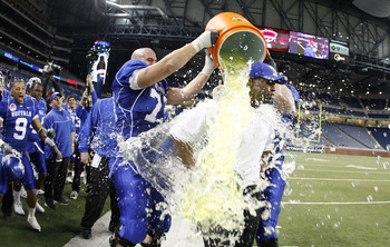 DETROIT - DECEMBER 05: Head coach Turner Gill of the Buffalo Bulls is showered with Gatorade by Peter Bittner #73 late in the fourth quarter during the MAC Championship game against the Ball State Cardinals on December 5, 2008 at Ford Field in Detroit, Mi
