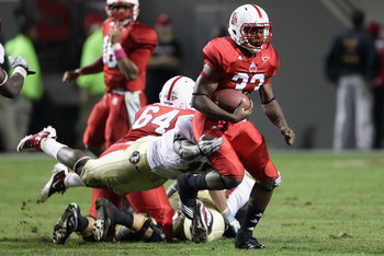 RALEIGH, NC - OCTOBER 28:  Mustafa Greene #33 of the North Carolina State Wolfpack runs with the ball against the Florida State Seminoles during their game at Carter-Finley Stadium on October 28, 2010 in Raleigh, North Carolina.  (Photo by Streeter Lecka/