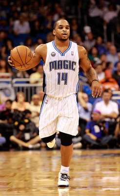 ORLANDO, FL - NOVEMBER 03:  Jameer Nelson #14 of the Orlando Magic sets up the offesnse during the game against the Minnesota Timberwolves at Amway Arena on November 3, 2010 in Orlando, Florida.  NOTE TO USER: User expressly acknowledges and agrees that,