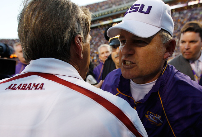 BATON ROUGE, LA - NOVEMBER 06:  Head coach Les Miles of the Louisiana State University Tigers is congratulated by Nick Saban of the Alabama Crimson Tide at Tiger Stadium on November 6, 2010 in Baton Rouge, Louisiana. The Tigers defeated the Crimson Tide 2