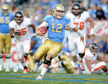 PASADENA, CA - NOVEMBER 06:  Richard Brehaut #12 of the UCLA Bruins scrambles for yards out of the pocket against the Oregon State Beavers during the first quarter at the Rose Bowl on November 6, 2010 in Pasadena, California.  (Photo by Harry How/Getty Im